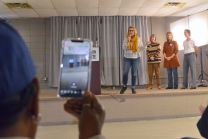 A volunteer captures remarks by labor-endorsed lieutenant governor candidate Peggy Flanagan on video.