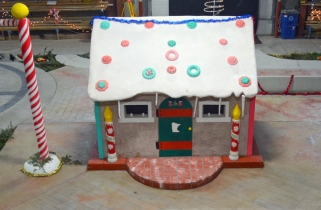 Apprentices from Plasters Local 265 erected the gingerbread house. Decorative concrete patterns on the floor around the structure simulate wood paneling and cobblestone.